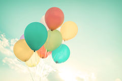 Colorful balloons in summer holidays. Pastel color filter Stock Photo