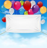 Colorful balloons with textile banner Stock Photos