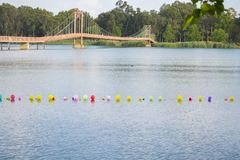 Colorful balloons on water and drawbridge background stock photo