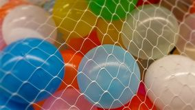 Colorful balloons in white net stock photos