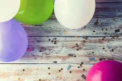 Colorful balloons on white vintage table. Copyspace Royalty Free Stock Images