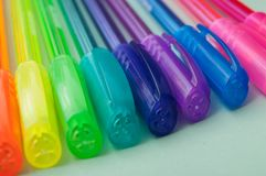 Colorful ballpoint pens on color background. Closeup of colorful ballpoint pens on color background royalty free stock photos