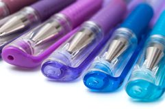 Colorful ballpoint pens on white background. Closeup of colorful ballpoint pens on white background royalty free stock photo