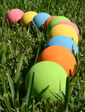 Colorful balls. A line of colorful rubber balls on the grass Royalty Free Stock Photo