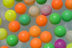 Colorful balls. Colorful floating plastic balls in the water as a background stock photography