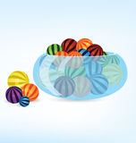 Colorful balls in bowl Stock Photography