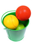 Colorful balls in bucket Royalty Free Stock Photography