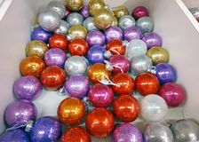 Red, gray, purple Christmas decorations in a box, top view royalty free stock images