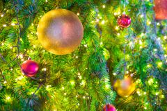 Colorful balls on a Christmas tree royalty free stock photos