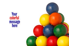 Colorful balls form a pyramid. Pyramid of colorful balls rises to its pinnacle;white background allows of message or logo to be added stock images