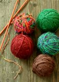 Colorful Balls From Wool And Spokes On Wooden Stock Images