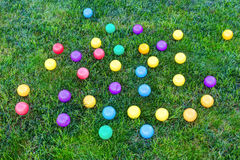 Colorful balls on the green grass. Stock Image
