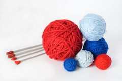 Colorful balls and needles for knitting lying Stock Image