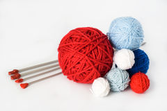 Colorful balls and needles for knitting lying Royalty Free Stock Photo
