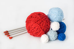 Colorful balls and needles for knitting lying Royalty Free Stock Image
