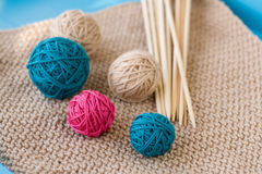 Colorful balls and needles lying on beige Stock Photos