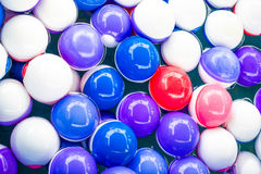 Colorful balls in water stock images