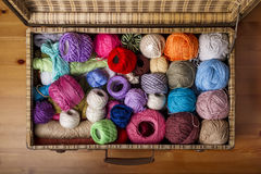 Colorful balls of wool in an old suitcase Royalty Free Stock Photo