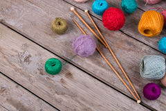 Colorful balls of wool on old wooden background. Royalty Free Stock Photos