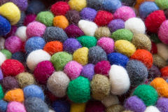 Colorful balls of wool tied together for background Stock Photos