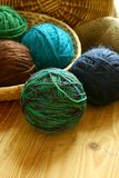 Colorful balls of wool on wooden background Stock Photo