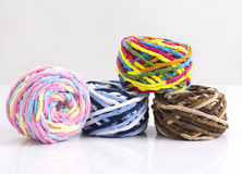 Colorful balls of woolen yarn Royalty Free Stock Images