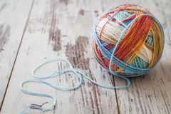 Colorful Balls of Yarn. For knitting on white wooden table Stock Images