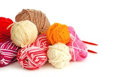 Colorful balls of yarn over white Royalty Free Stock Photo