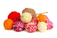 Colorful balls of yarn over white Royalty Free Stock Image