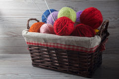 Colorful balls of yarn on a table royalty free stock photos