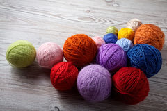 Colorful balls of yarn on a table stock photography
