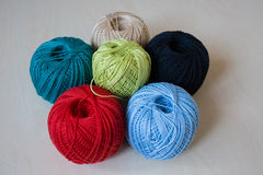 Colorful balls of yarn on a table Royalty Free Stock Image