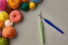 Colorful balls of yarn. Colorful balls of yarn on white wooden background Stock Photos