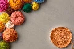 Colorful balls of yarn. Colorful balls of yarn on white wooden background Royalty Free Stock Photo
