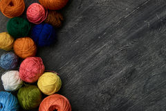 Colorful balls of yarn. Colorful balls of yarn on wooden background of chalk board Stock Photos