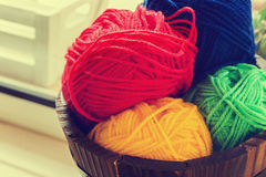 Colorful balls of yarn. In a wooden basket Royalty Free Stock Photos