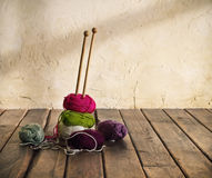 Colorful balls of yarn on a wooden table Stock Photography