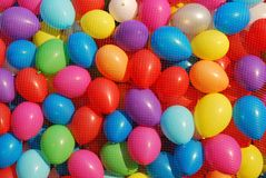 Colorful Baloons. Colorful inflated baloons in giant plastic basket Royalty Free Stock Images