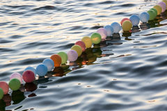 Colorful baloons on the sea Royalty Free Stock Images