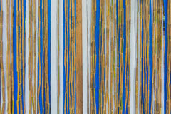 Colorful bamboo fence on wood texture for background Royalty Free Stock Photo