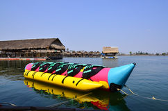 Colorful banana boat floating on the water Royalty Free Stock Photos