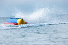 Colorful banana boat floating on the water Stock Image