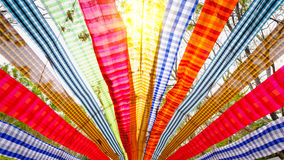 Colorful bar of Loincloth with lighting flare effect at countryside, Thailand Royalty Free Stock Image