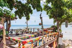 Colorful bar at the shore on a tropical island. Hippie shack at the shore on tropical island Koh Pangan. Esco Bar at sunset beach Haad Rin. May 03, 2016 Royalty Free Stock Photography