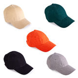 Colorful baseball caps Stock Images