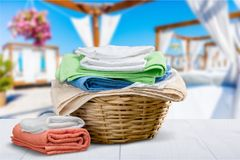 Laundry Basket with colorful towels on background. Colorful basket laundry towels colors background nobody Royalty Free Stock Photos