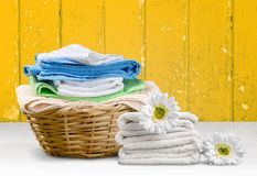 Laundry Basket with colorful towels on background. Colorful basket laundry towels colors background nobody Stock Image