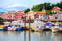 Colorful basque houses in port of Saint-Jean-de-Luz, France Stock Photography