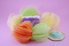 Colorful bath sponge with peeling soap and sea salt Royalty Free Stock Photo