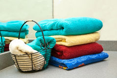 Colorful Bath Towels. And cloths stacked on a bathroom vanity Stock Photos